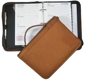 "3-Ring Refill Dimensions: 5-3/8"" x 8-1/2""  Zip-around Leather Agenda"